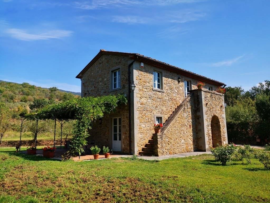Outside of the villa in Cortona for sale