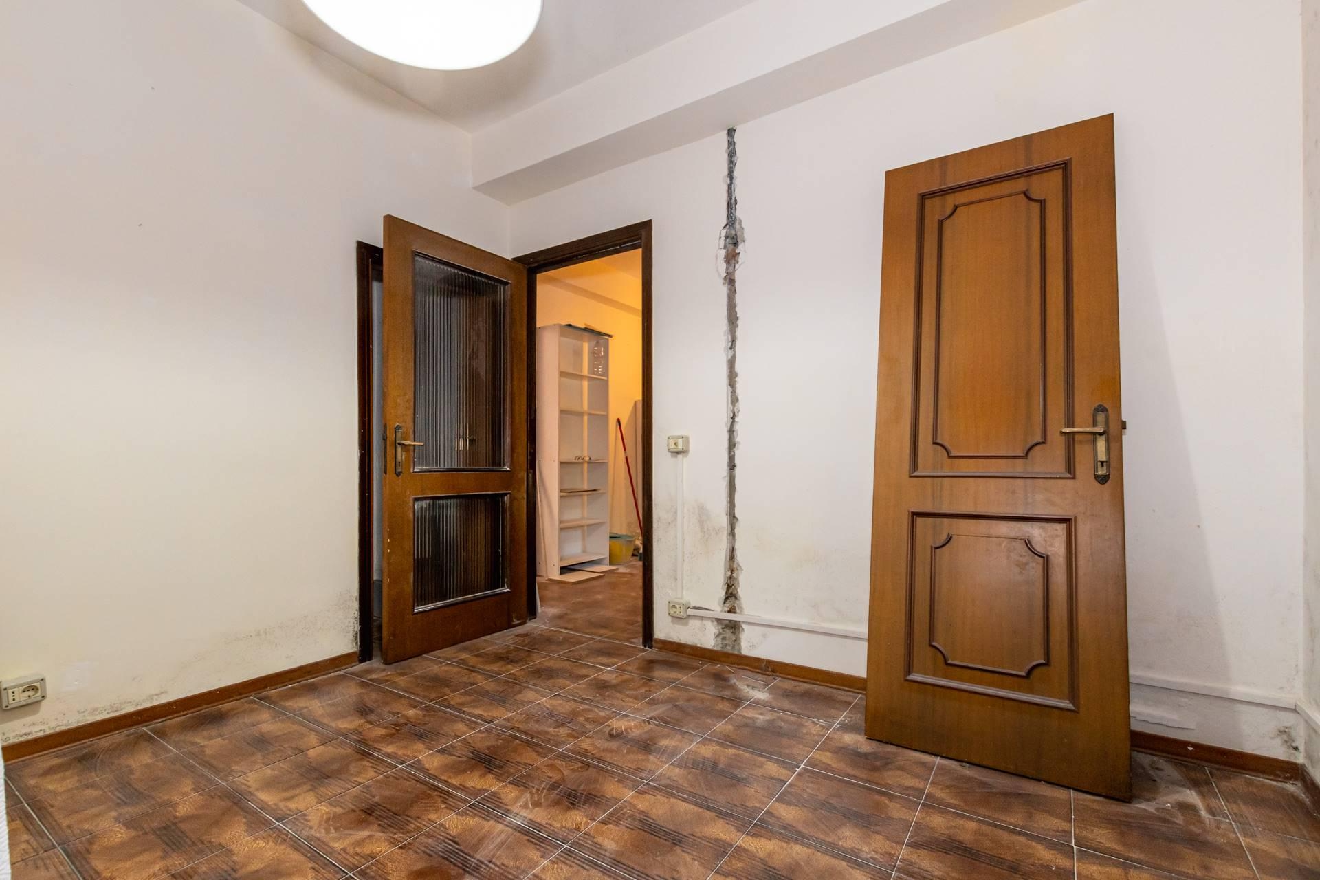 Camera singola con ripostiglio