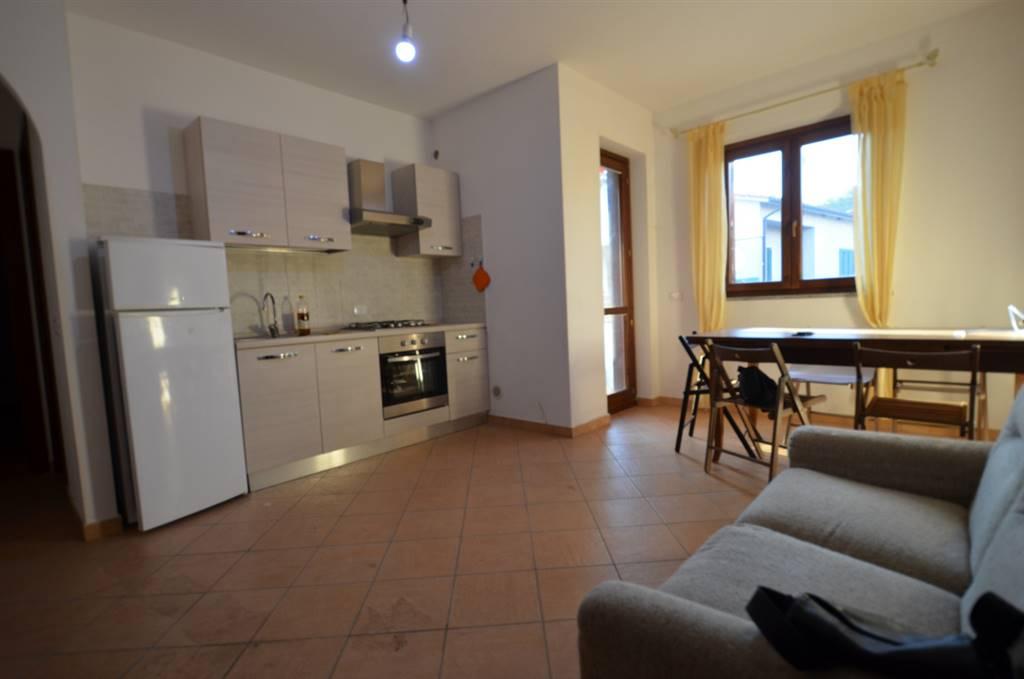 STIMIGLIANO SCALO - appartamento in palazzina di recente costruzione posto al primo piano composto da: soggiorno con cucina a vista, camera, bagno e