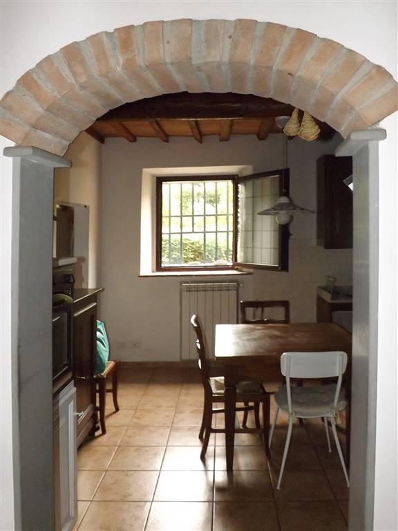 archetto in cotto verso cucina