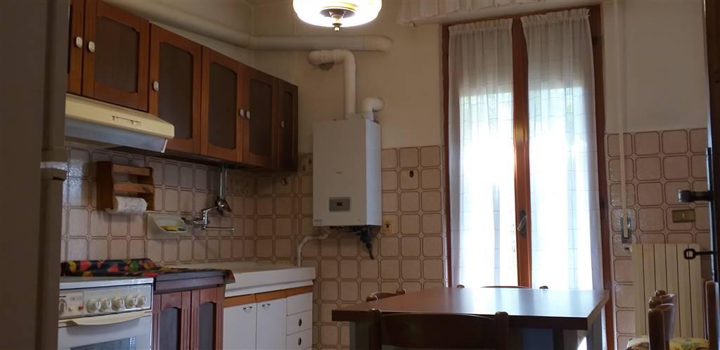 Cucina con balcone