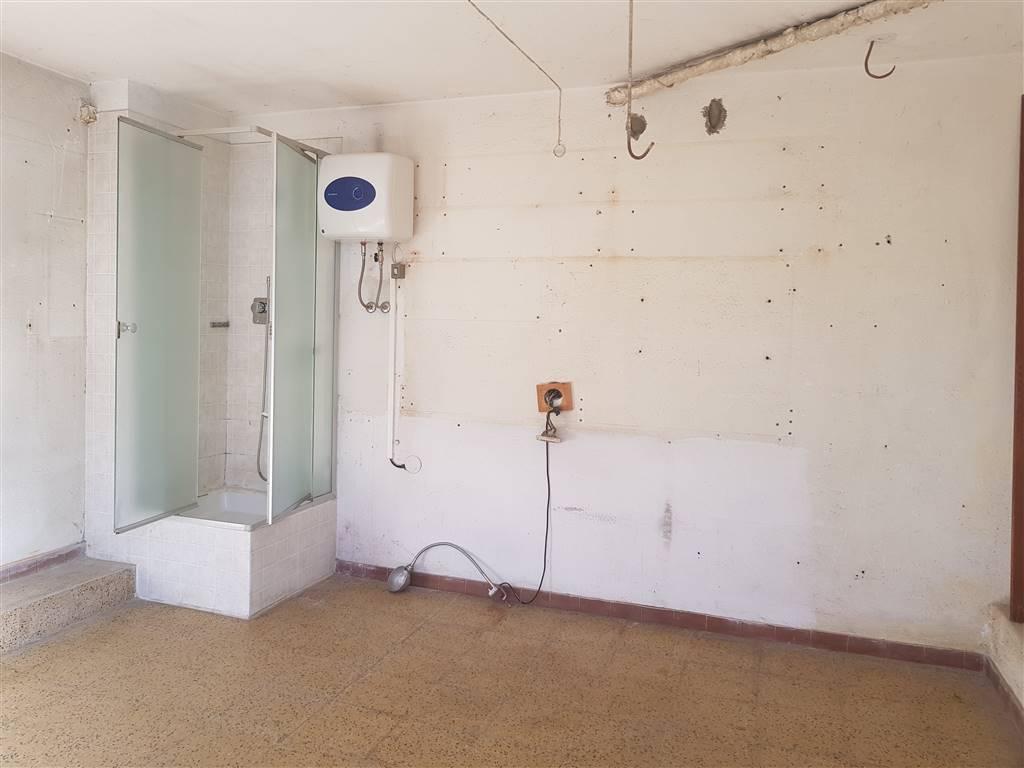 Garage con doccia