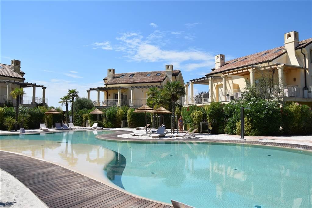 JESOLO Appartamento con piscina e giardino privato Foto 4