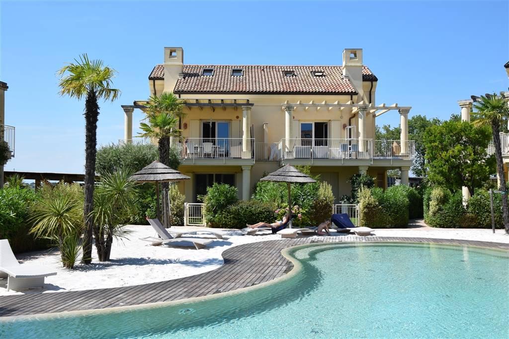 JESOLO Appartamento con piscina e giardino privato Foto 5