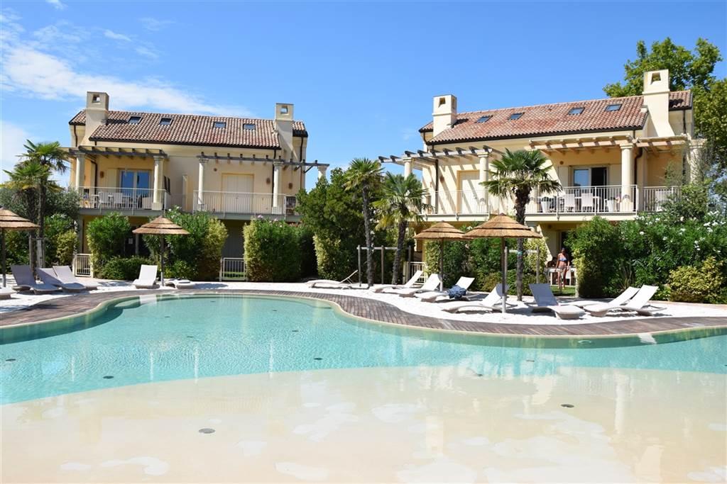 JESOLO Appartamento con piscina e giardino privato Foto 9