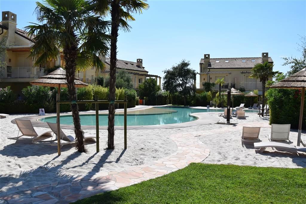 JESOLO Appartamento con piscina e giardino privato Foto 10