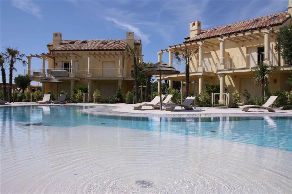 JESOLO Appartamento con piscina e giardino privato Foto 6