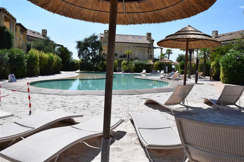 JESOLO Appartamento con piscina e giardino privato Foto 3