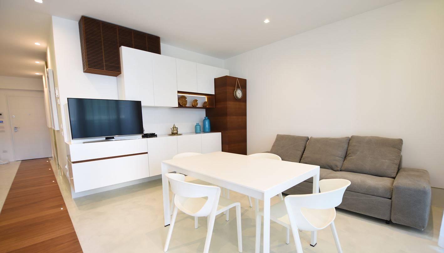 PIAZZA DRAGO L'appartamento è situato in una palazzina prestigiosa di recente realizzazione ubicata nelle vicinanze della piazza Marconi a ca. 300 m