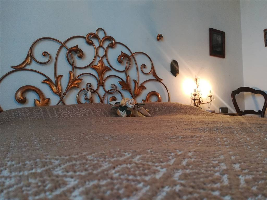 particolare letto