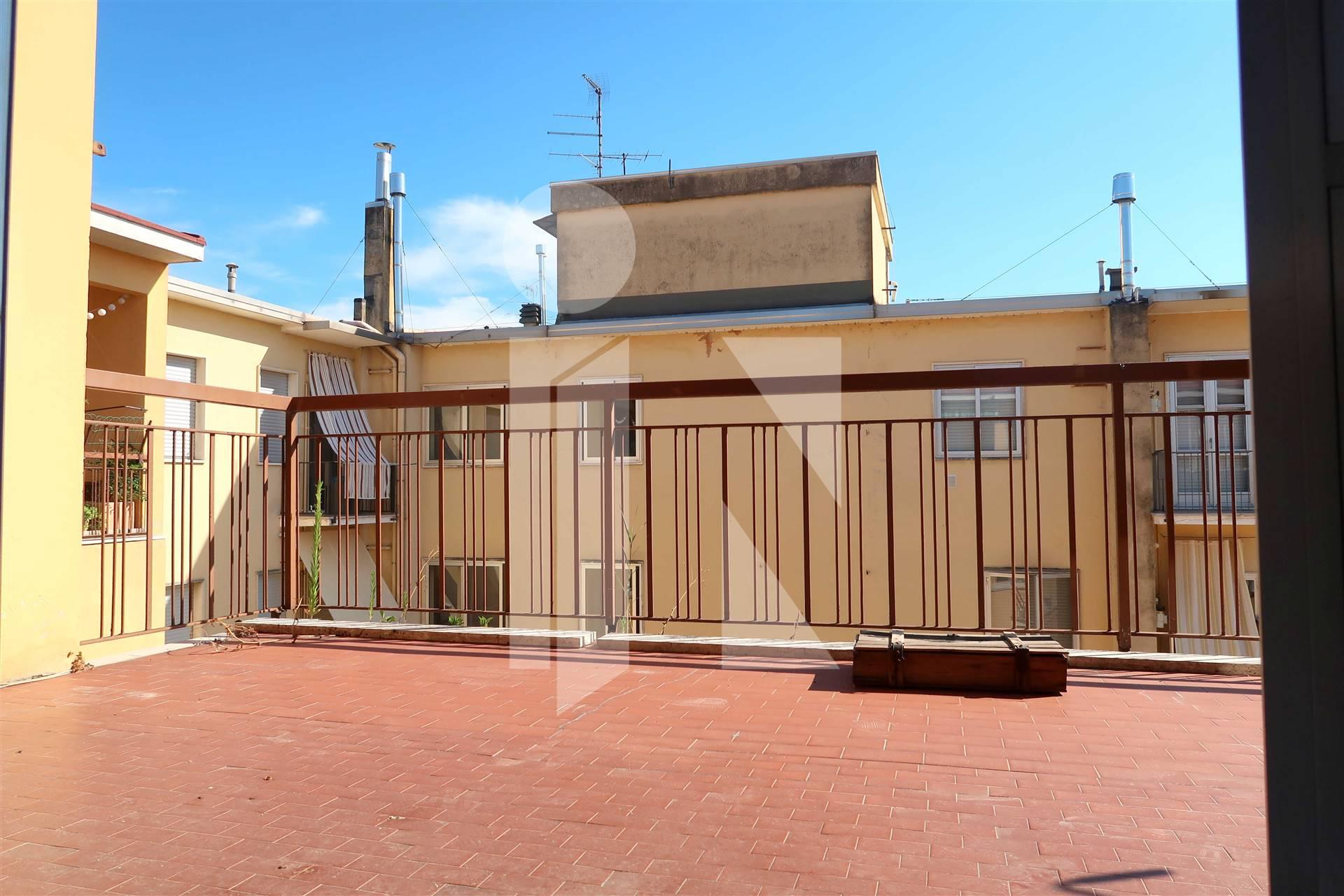 Attico con terrazze e garage