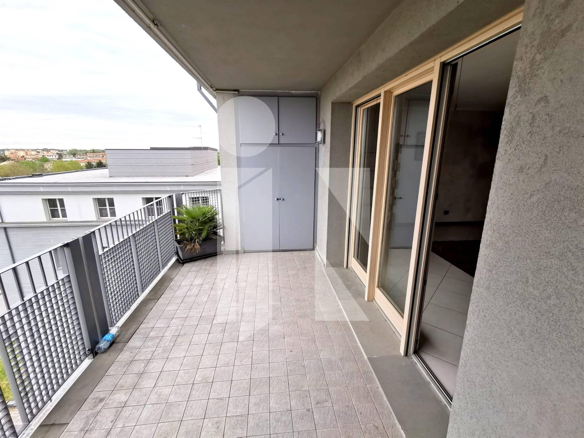 Moderno attico con terrazze